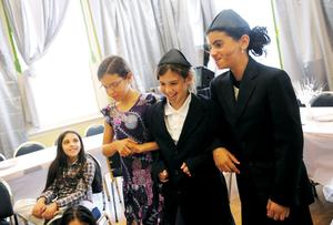 Iris Brook, Mariana Gubert and Michal Youshei perform their part in a mock wedding at the Shaloh House's day camp on Aug. 3. Wicked Local staff photo by Kate Flock